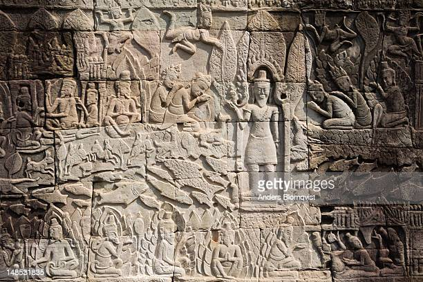 detail of bas relief depcting worship of king on the bayon , angkor thom. - bas relief stock pictures, royalty-free photos & images