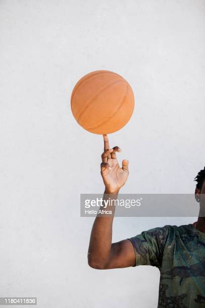 detail of basketball player spinning ball on finger - drive ball sports stock pictures, royalty-free photos & images