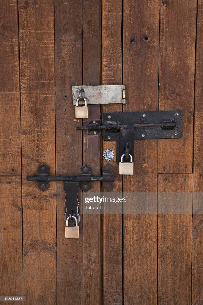 Detail of bolted locks on a wooden door  Stock Photo & Detail Of Bolted Locks On A Wooden Door Stock Photo | Getty Images