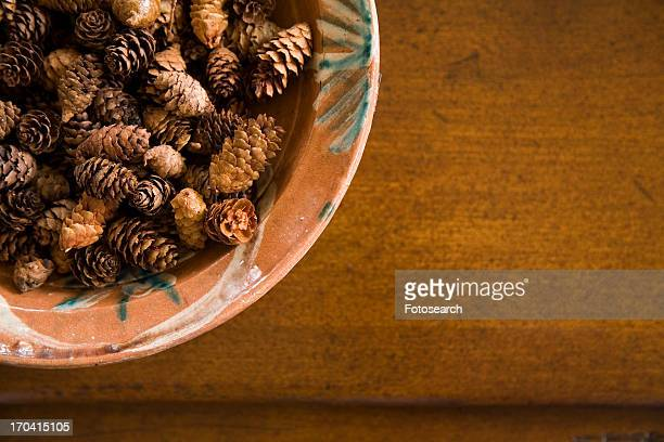 Detail of bowl filled with miniature pine cones