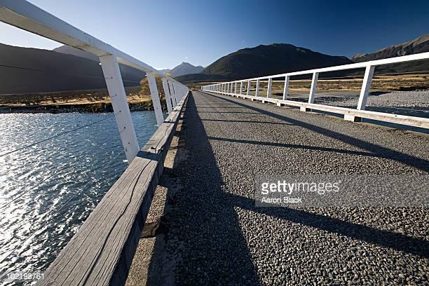 detail of bridge crossing river in large valley