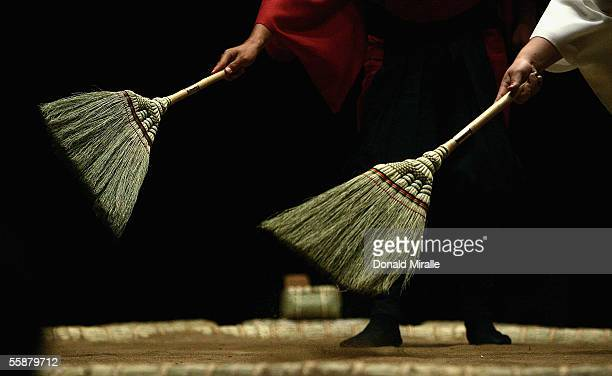 A detail of brooms sweeping loose clay off the ring during the Grand Sumo Championship on October 7 2005 at Mandalay Bay Events Center in Las Vegas...