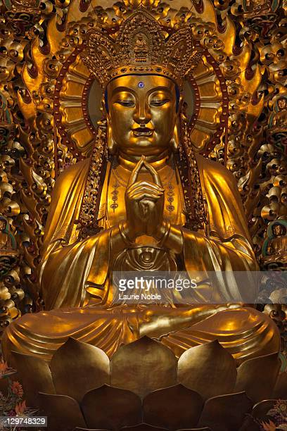 detail of buddha statue, longhua temple; shanghai - longhua temple stock photos and pictures