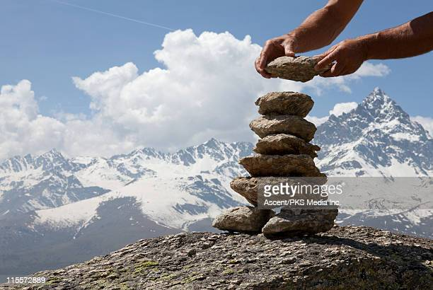 detail of building a rock cairn on mtn summit - 石塚 ストックフォトと画像
