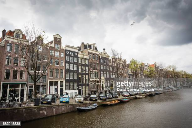 Detail of buildings along the edge of the Singel canal in Amsterdam taken on April 18 2016