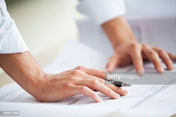 detail of businessman working on blueprint