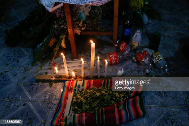 Detail of candles and coca leaves during the funeral of Antonio Ronaldo Quispe Ticona who was killed during clashes with police at the Senkata fuel...