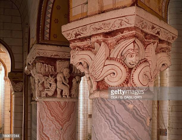 Detail of capitals with dragons and monsters, Church of Saint-Pierre, Chauvigny, France.