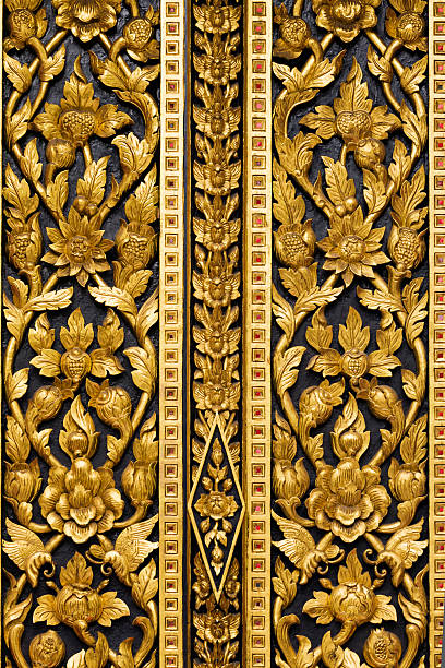 Detail of carved wooden door with floral motifs at Wat Intharawihan.