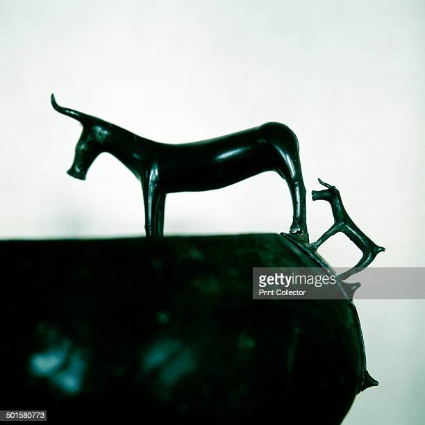 Detail of Celtic bronze bowl showing a cow and calf Hallstatt Austria 6th century BC