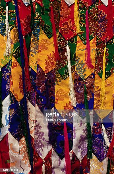 detail of ceremonial banners used in the mani rimdu festival at chiwang gompa (monastery). - mani rimdu festival stock pictures, royalty-free photos & images