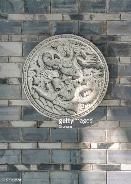 detail of chinese dragon statue with sunlight - bas relief stock pictures, royalty-free photos & images