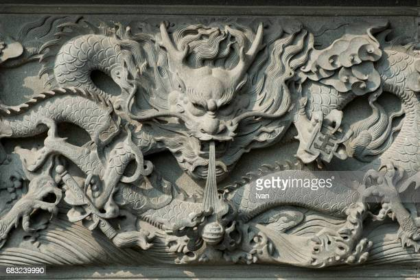 detail of chinese dragon statue with sunlight - chinese dragon stock photos and pictures