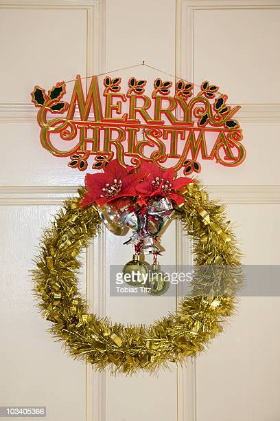 Detail of Christmas decorations hanging on a door