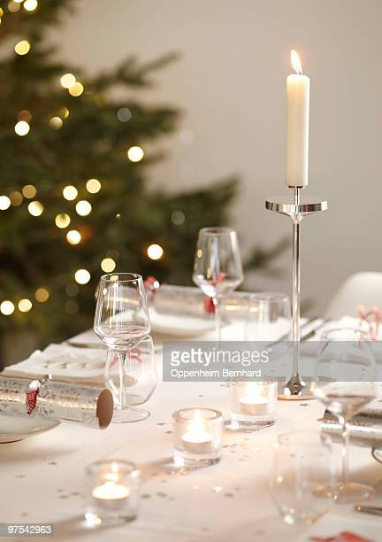 detail of christmas table with tree in background