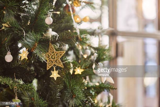 detail of christmas tree with copy space. - christmas decoration stock pictures, royalty-free photos & images