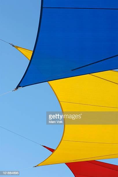detail of colored tarpaulins - 防水シート ストックフォトと画像