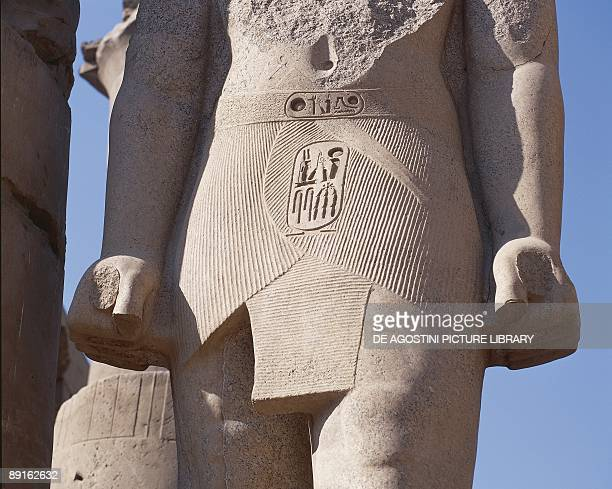 Detail of colossal statue of pharaoh with cartouche of Court of Ramses II