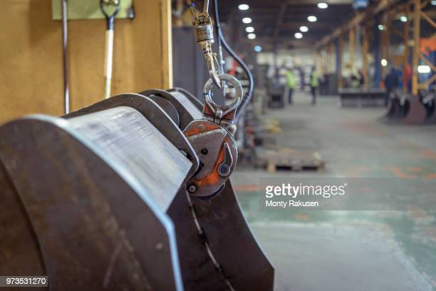 detail of crane in engineering factory - monty rakusen stock pictures, royalty-free photos & images