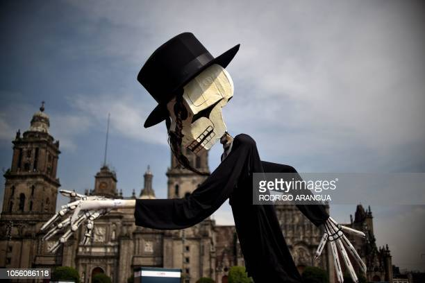 TOPSHOT Detail of decorations regarding the Day of the Dead at the Zocalo square in Mexico City on November 1 2018