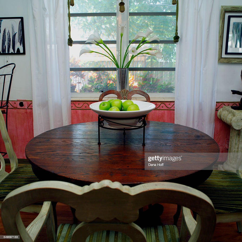 Detail Of Dining Room Table With Fruit Bowl Centerpiece Stock Photo