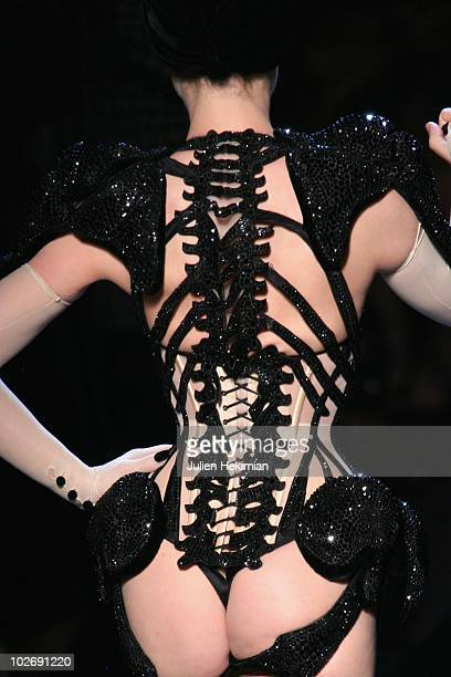 A detail of Dita Von Teese as she walks the runway during the JeanPaul Gaultier show as part of the Paris Haute Couture Fashion Week Fall/Winter 2011...