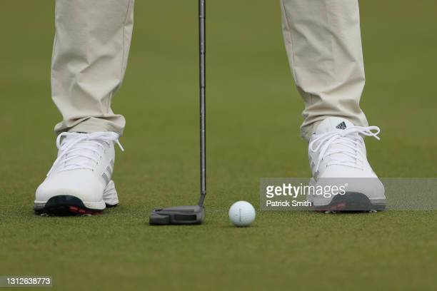Detail of Dustin Johnson of the United States Adidas shoes on the 13th green during the first round of the RBC Heritage on April 15, 2021 at Harbour...