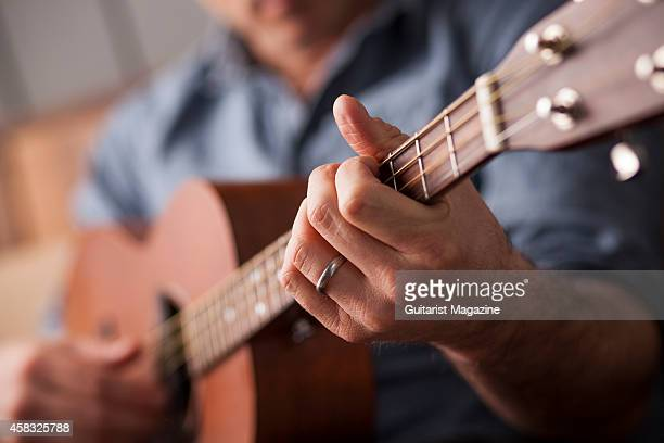 Detail of English folk musician Seth Lakeman photographed playing his Martin 515T custom tenor guitar in Bath England on January 24 2014