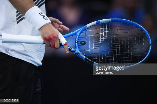 Detail of Fabio Fognini of Italy hand a racquet during his Men's Singles fourth round match against Tennys Sandgren of the United States on day seven...