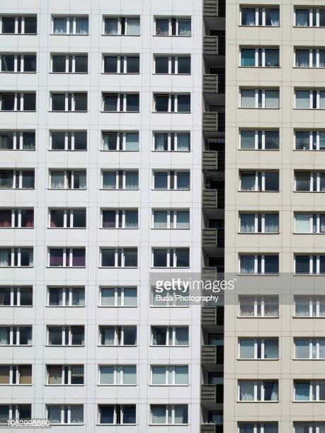 detail of facade of typical prefabricated concrete slab building (plattenbau) in the center of east berlin, germany - ugly wallpaper stock photos and pictures