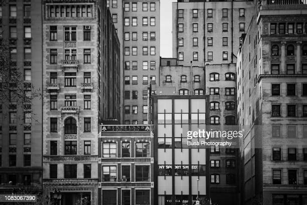 detail of facades of buildings facing union square along broadway. manhattan, new york city - union square new york city stock pictures, royalty-free photos & images