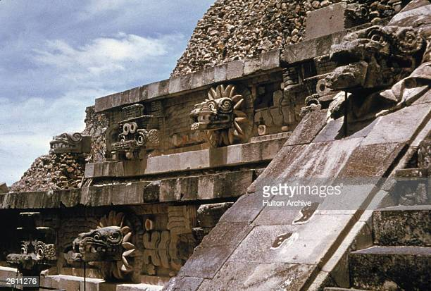Detail of figures on the Temple of Quetzalcoatl at Teotihuacan near Mexico City Mexico c 1980