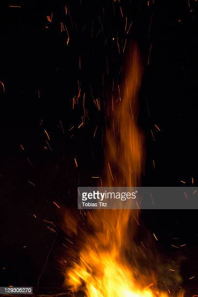 detail of flames of a fire - sparks stock pictures, royalty-free photos & images