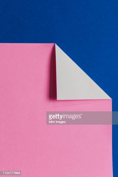 detail of folded pink & blue origami paper - corner stock pictures, royalty-free photos & images