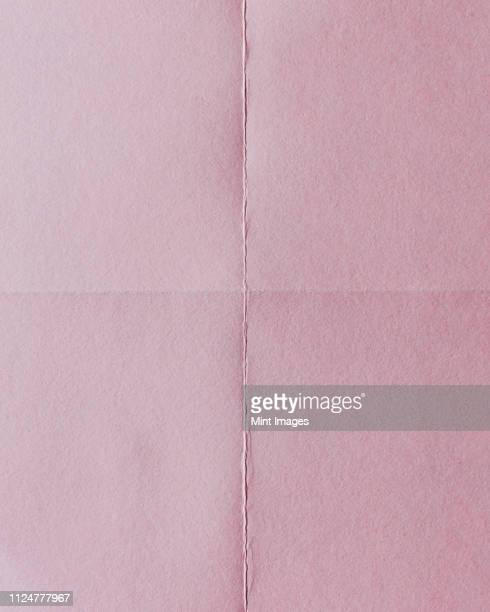detail of folded pink paper - folded stock pictures, royalty-free photos & images