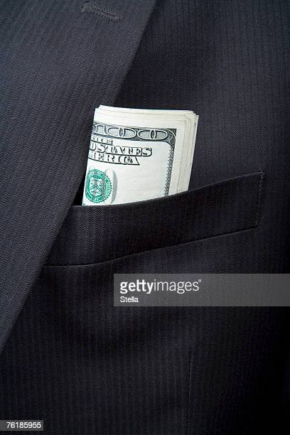 detail of folded us bank notes in a suit pocket - revers stock-fotos und bilder