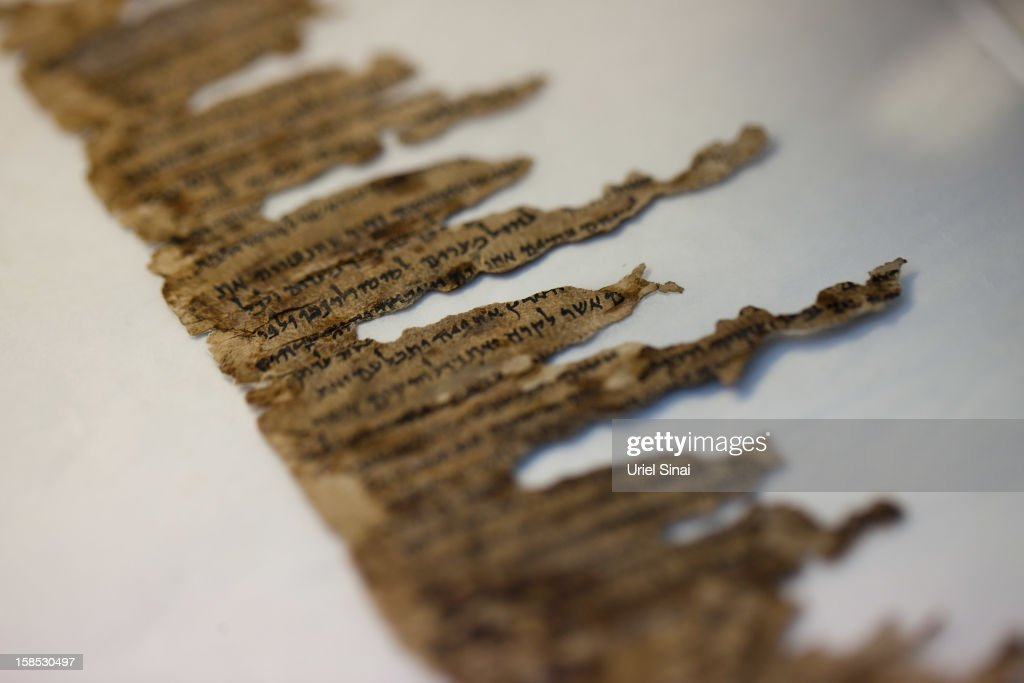 A detail of fragments of the 2000-year-old Dead Sea scrolls at a laboratory before photographing them on December 18, 2012 in Jerusalem, Israel. More than sixty years after their discovery Israel have put 5,000 fragments of the ancient Dead Sea scrolls online in a partnership with Google.