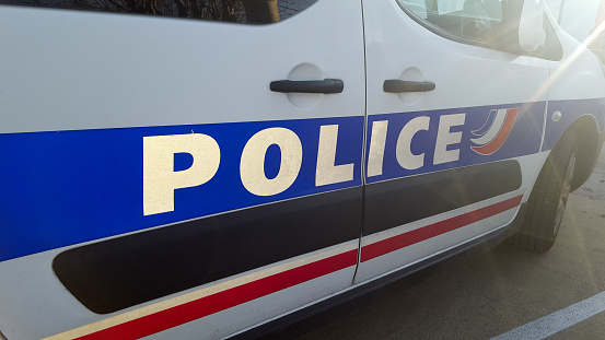 detail of french police car with sun in summer day 1089712514