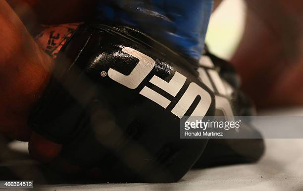 A detail of gloves worn by Anthony Pettis and Rafael dos Anjos in the Lightweight Title bout during the UFC 185 event at American Airlines Center on...