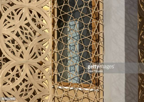 Detail of gold perforated patterned metal screen Jumaa Mosque Doha United Arab Emirates Architect John McAslan Partners 2017