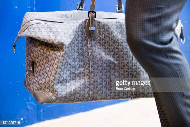 Detail of Goyard bag carried by Tyrod Taylor of the Buffalo Bills as he walks into New Era Field before the game between the Buffalo Bills and the...