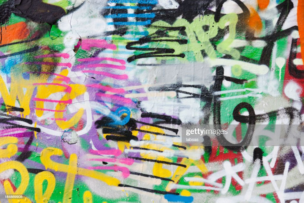 Detail of graffiti painted illegally on public wall. : Stock Photo