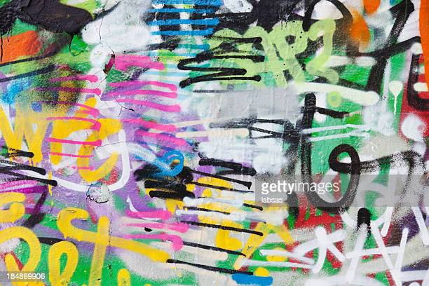 detail of graffiti painted illegally on public wall. - abstract pattern stock pictures, royalty-free photos & images