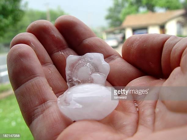 Detail Of Hailstone In Man's Hand
