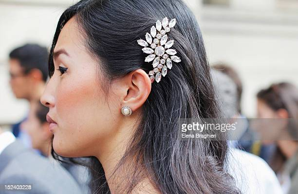 A detail of hairdo outside the Gucci show during Milan Fashion Week Womenswear Spring/Summer 2013 on September 19 2012 in London England