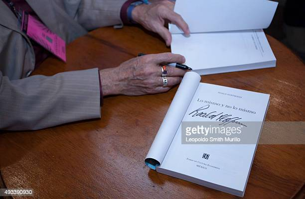 Detail of hands of Nobel Laureate Roald Hoffmann as he signs a book during the conference La química del arte y el arte de la química as part of the...