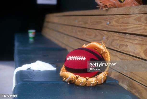 Detail of his baseball glove and a soft football used for warming up on the bench when 2nd Baseman Roberto Alomar of the Toronto Blue Jays appears in...