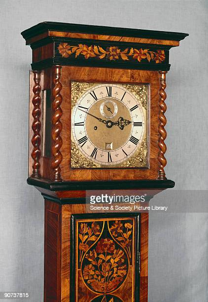 Detail of hood and dial Made by Richard Baker of London this is a typical example of an English long case clock in a marquetry case The clock...