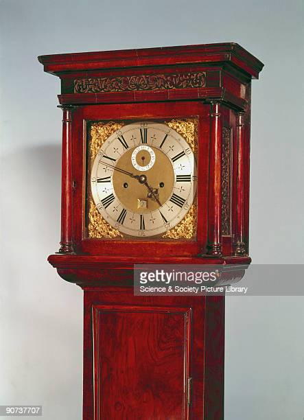 Detail of hood and dial This long case clock in a walnut case was made by Thomas Tompion one of the finest English clockmakers Long case clocks were...