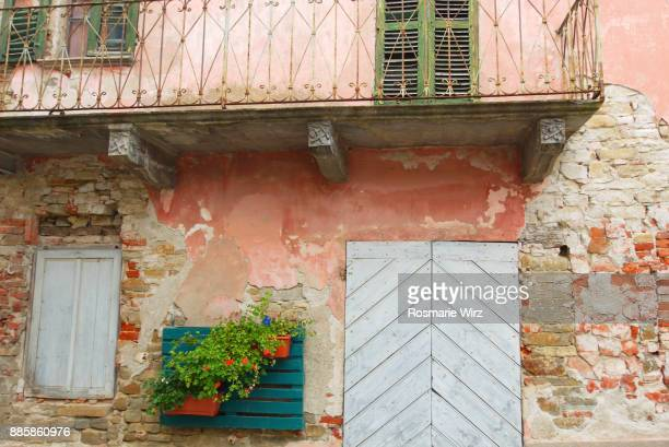 Detail of house facade in the historical town center of Castino.